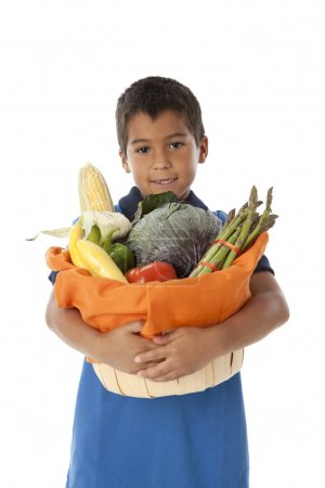Healthy Eating. Hispanic little boy holding a basket arranged with fresh vegetables