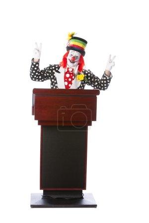 Clowns. Adult clown standing at a podium giving a speech