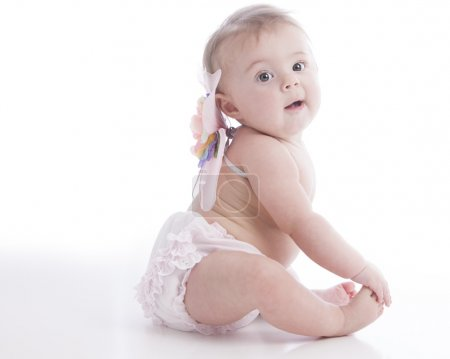 Closeup of a 7 month old caucasian baby girl dressed in an angel costume