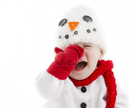 Little baby dressed up as snowman cries and throws a temper tantrum