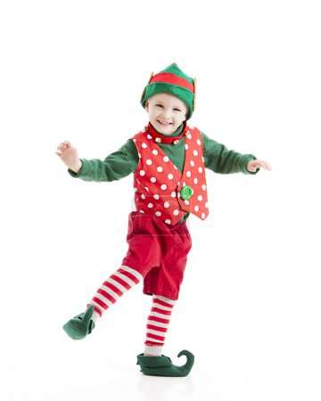 boy dressed as a christmas elf, dances a gleeful Jig