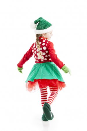 One of santas little girl christmas elves dances and twirls
