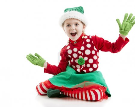Surprised excited little girl dressed as a christmas elf