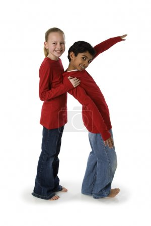 Photo for Multicultural children work together to form letters of the alphabet with their bodies. - Royalty Free Image