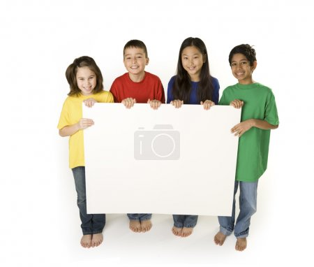 Photo for Multicultural children hold a sign. Add your own message - Royalty Free Image