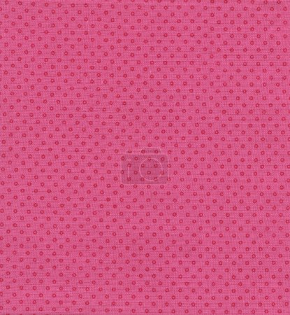 A high resolution bright pink fabric with darker pink polka dots in a pattern