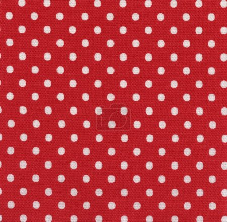 A high resolution bright red fabric with white polka dots