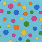 A high resolution blue fabric with multi-colored polka dots
