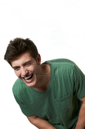 Young handsome male model laughing posing white background studio shot with copy space