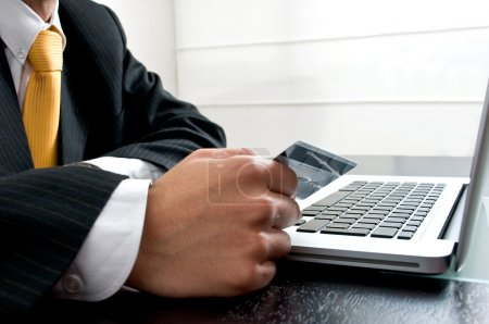 e-commerce concept: man at office paying online