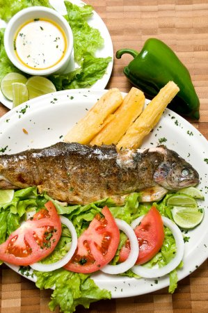 Ecuadorian food series: fried fish on a plate with yucca and sal