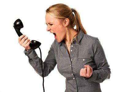 Foto de Mujer de negocios gritando en el teléfono - Imagen libre de derechos