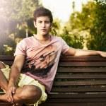 Young man fashion shot at summer day...