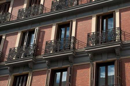 Architecture, brick spanish buildings with terraces