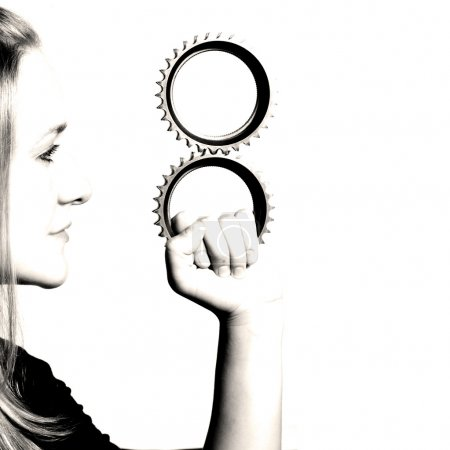 girl holding gears business concept