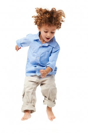 Photo for Young happy kid jumping - Royalty Free Image