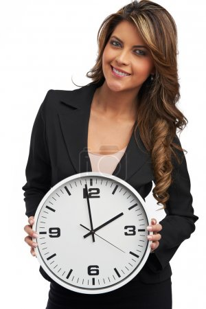 Photo for Business woman holding clock. Isolated over white - Royalty Free Image