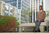 Young successful black business man in the city
