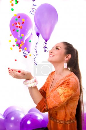 Photo for Smiling girl catching falling sweets and candies - Royalty Free Image