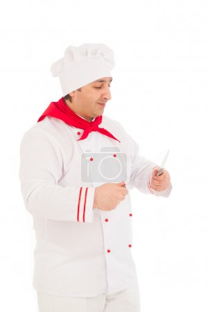 Smiling chef holding two knifes wearing red and white uniform