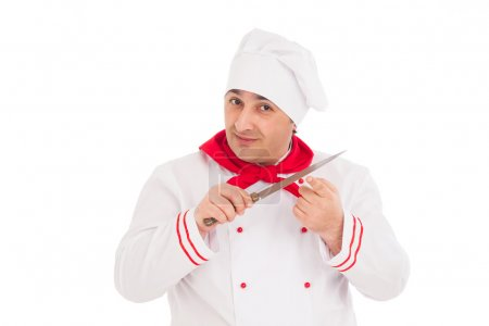 Photo for Chef holding knife wearing red and white uniform over white background - Royalty Free Image
