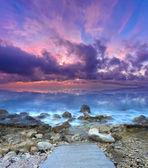 Sundown on the sea with stone