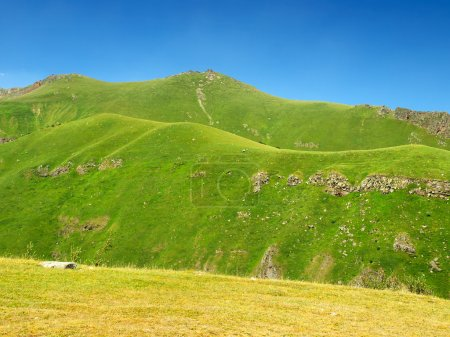 Photo for Green hill in mountain valley. Natural summer landscape - Royalty Free Image