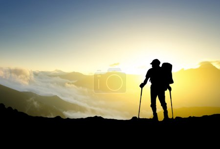 Photo for Tourist on mountain top. Sport and active life - Royalty Free Image