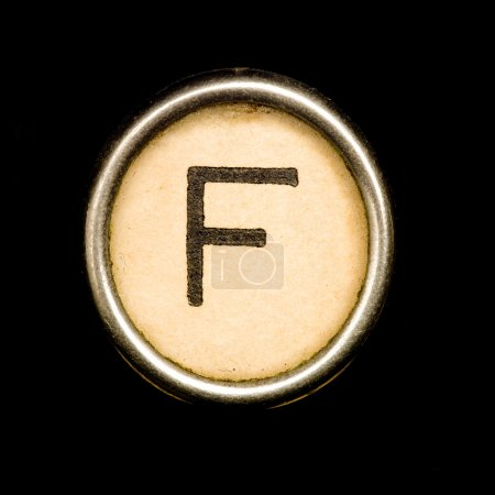 The F button on a complete alphabet of an antique typewriter