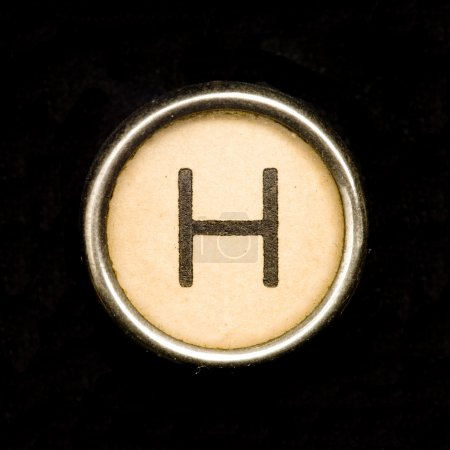 The H button on a complete alphabet of an antique typewriter