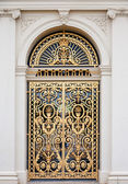 Golden ornate door of the Loo Palace in Apeldoorn, the Netherlands