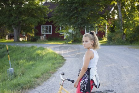 Child on bicycle on country road