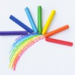 Kid's drawn rainbow and colorful crayons on white ...