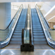Escalators in a shopping mall , long exposure time