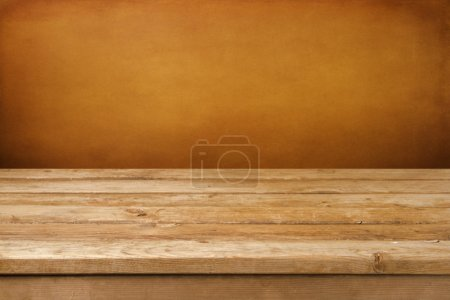 Vintage background with wooden deck table and grun...