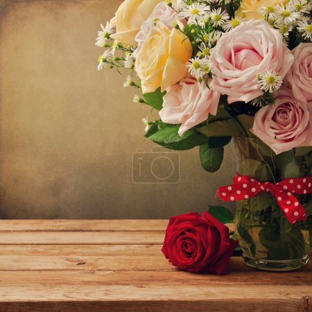 Background with beautiful roses bouquet