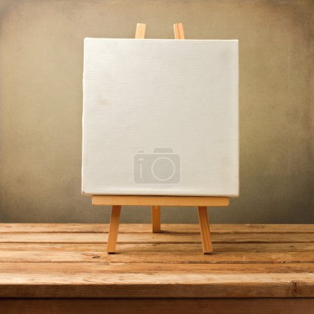 Background with blank canvas on wooden table