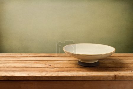 Retro background with plate on wooden table