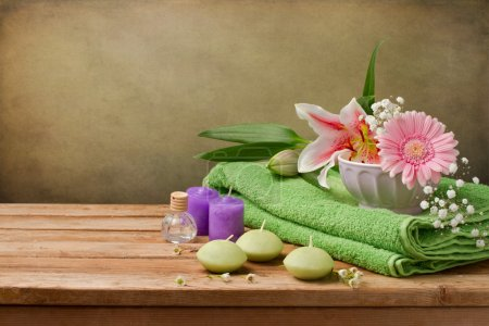 Spa concept still life with candles, towels and flowers