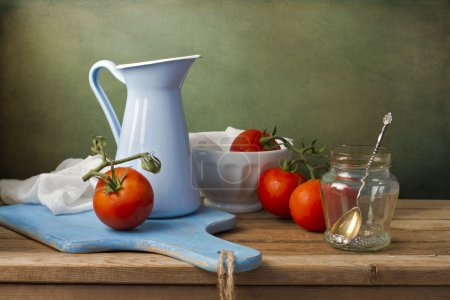 Photo for Still life with fresh tomatoes and tableware on wooden table - Royalty Free Image