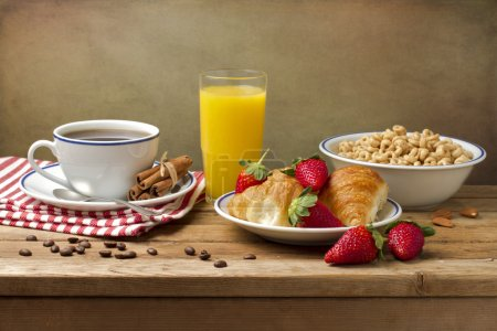 Photo for Breakfast setting on wooden table - Royalty Free Image
