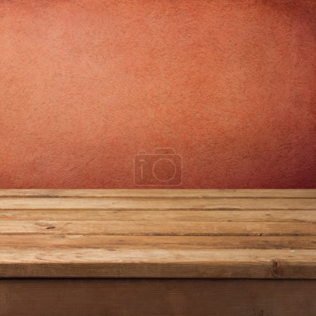 Background with empty wooden deck table and grunge rough wall