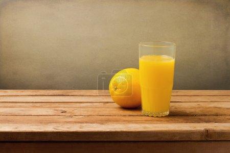 Fresh orange juice on vintage wooden table