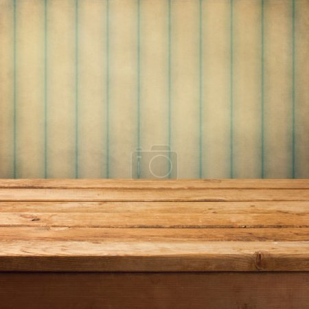 Wooden deck table over grunge vintage background
