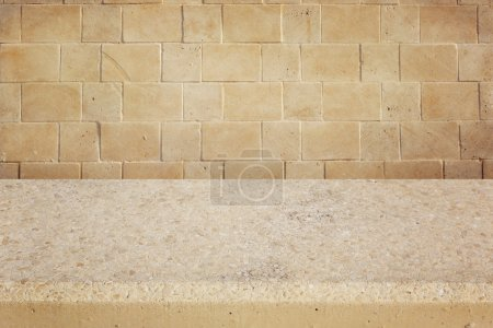 Background with concrete table and stone wall