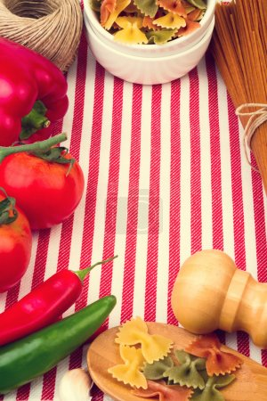 Background with striped tablecloth and raw food