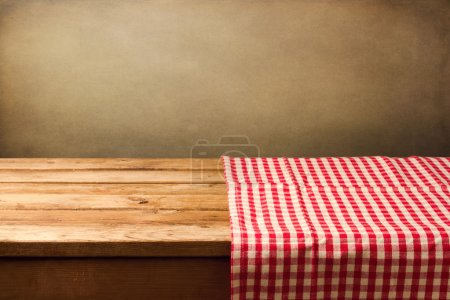 Photo for Empty wooden table covered with red checked tablecloth. Background for product montage - Royalty Free Image