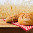 Fresh bread on tablecloth on wooden vintage table ...