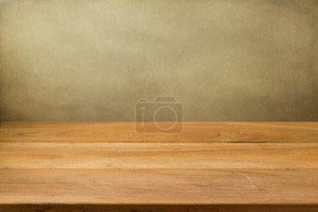 Photo for Empty wooden table over grunge background. Perfect for product montage. - Royalty Free Image
