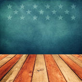 Empty wooden deck table over USA flag background.